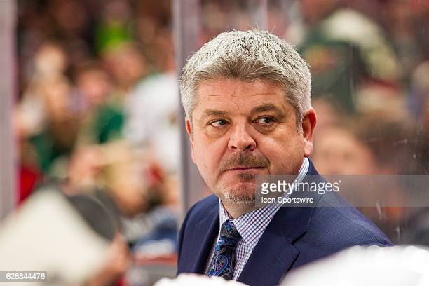 Edmonton Oilers head coach Todd McLellan talks to one of his assistant coaches in the 2nd period during the Western Conference match up between the...
