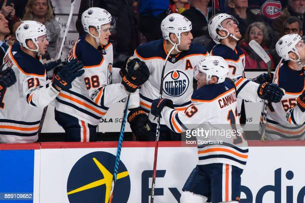 Edmonton Oilers left wing Michael Cammalleri celebrates with teammates after opening the score during the first period of the NHL game between the...