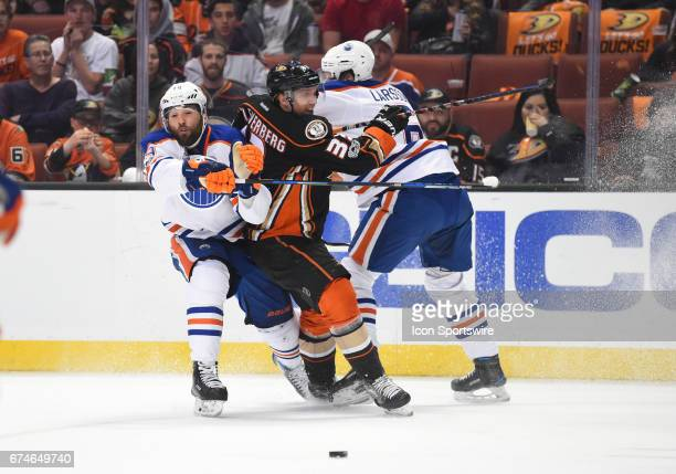 Edmonton Oilers Left Wing Patrick Maroon and Edmonton Oilers Defenceman Adam Larsson sandwich check Anaheim Ducks Right Wing Jakob Silfverberg during...