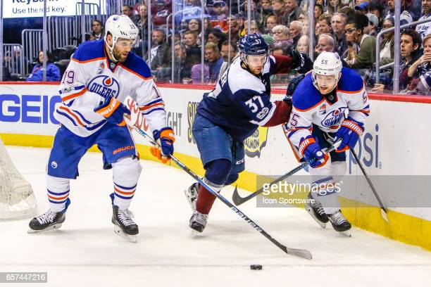 Edmonton Oilers Left Wing Patrick Maroon Colorado Avalanche Center JT Compher and Edmonton Oilers Center Mark Letestu fight for loose puck during the...