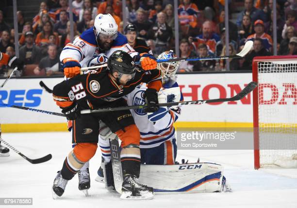 Edmonton Oilers Left Wing Patrick Maroon shoves Ducks Nicolas Kerdiles after a save by Edmonton Oilers Goalie Cam Talbot during game 5 of the second...