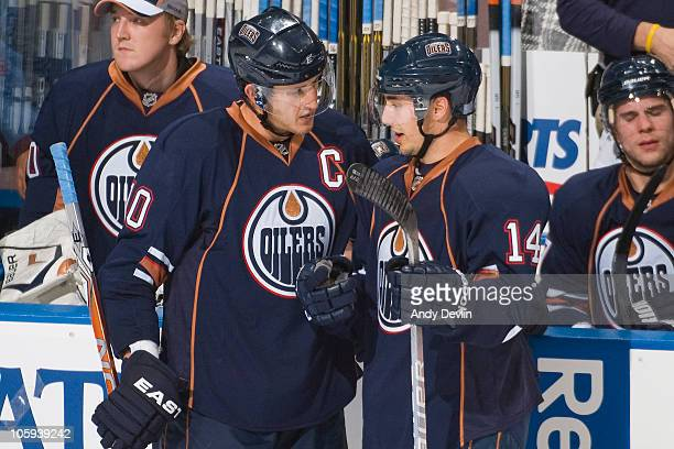 Edmonton Oilers left wing Shawn Horcoff chats with Jordan Eberle during a game against the Minnesota Wild at Rexall Place on October 21 2010 in...