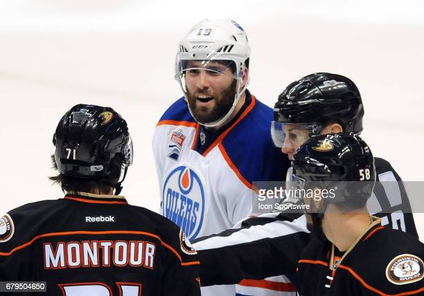 Edmonton Oilers leftwing Patrick Maroon has words with Anaheim Ducks players after Maroon hit leftwing Nicolas Kerdiles in the neck with his stick...