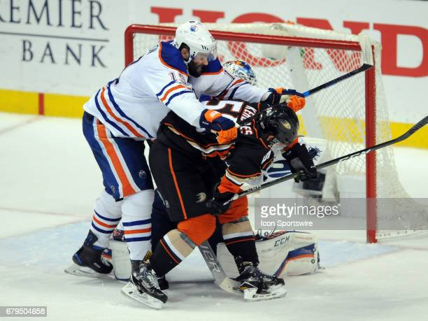 Edmonton Oilers leftwing Patrick Maroon lays into Anaheim Ducks leftwing Nicolas Kerdiles neck with his stick during game 5 of the second round of...