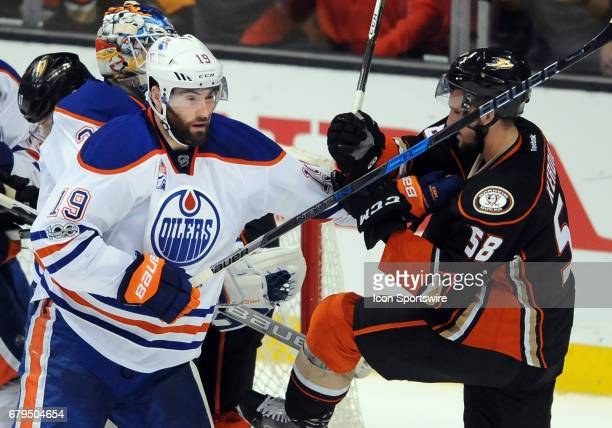 Edmonton Oilers leftwing Patrick Maroon with Anaheim Ducks leftwing Nicolas Kerdiles after Maroon hit Kerdiles in the neck with his stick during game...