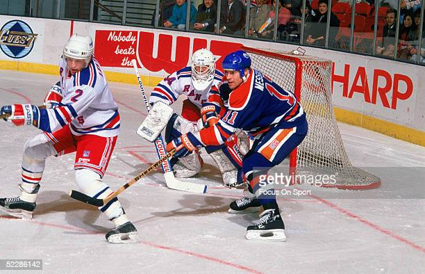 Edmonton Oilers' Mark Messier tries to disrupt the New York Rangers' defenseman Brian Leetch in front of the net during a game at Madison Square...