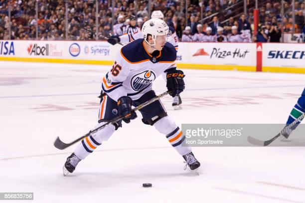 Edmonton Oilers right wing Kailer Yamamoto waits to shoot the puck during their NHL preseason game against the Vancouver Canucks at Rogers Arena on...