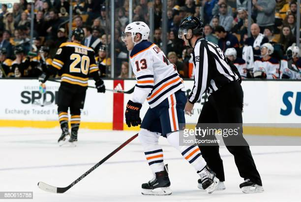 Edmonton Oilers right wing Michael Cammalleri escorted to the penalty box by linesman Ryan Galloway during a game between the Boston Bruins and the...