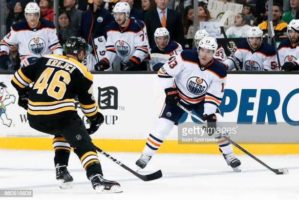 Edmonton Oilers right wing Michael Cammalleri eyes Boston Bruins center David Krejci during a game between the Boston Bruins and the Edmonton Oilers...