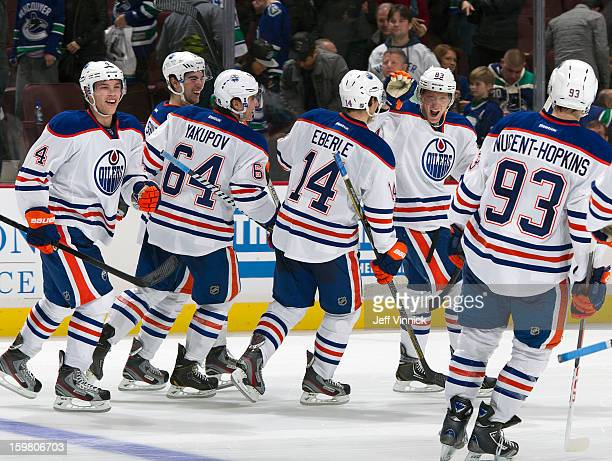 Edmonton Oilers skate to congratulate Ales Hemsky who scored the shootout winning goal against the Vancouver Canucks during their NHL game at Rogers...