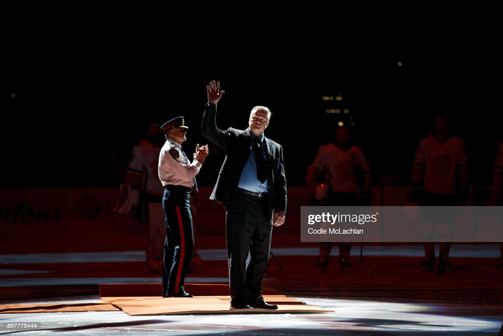 Edmonton Police Service Cst. Michael Chernyk waves to the crowd before the Edmonton Oilers home opener against the Calgary Flames at Rogers Place on October 4, 2017 in Edmonton, Canada. Cst. Chernyk survived being run over then stabbed in a terrorist attack in Edmonton last week.