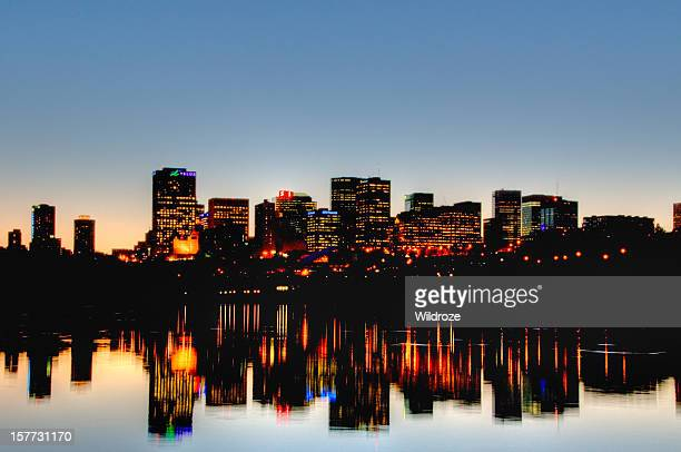 Edmonton skyline at sunset reflected in river