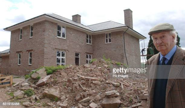 Edmund Carlisle at his newly rebuilt home at Llanigon near HayonWye after telling how police forced him to stand by and watch as his home and...