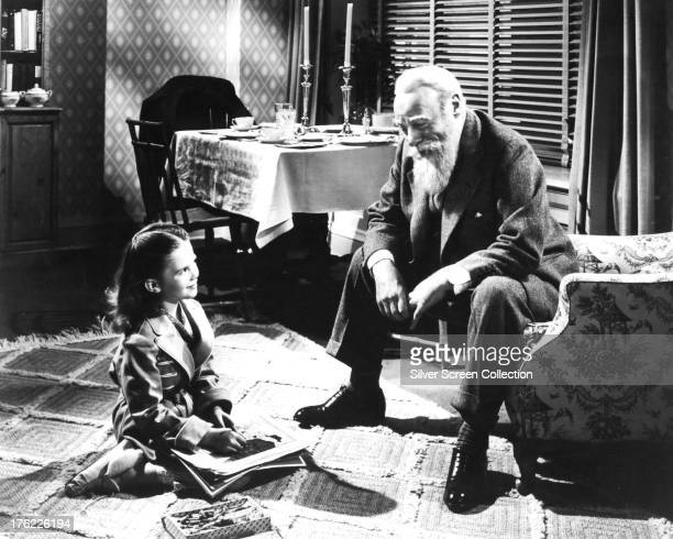 Edmund Gwenn as Kris Kringle and Natalie Wood as Susan Walker in 'Miracle On 34th Street' written and directed by George Seaton 1947
