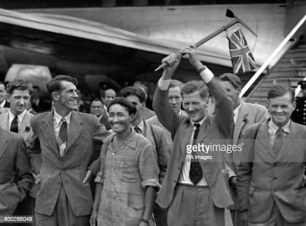 Edmund Hillary of New Zealand and the Sherpa Tensing Norgay stepped from a BOAC airliner at Heathrow Airport in London to receive a huge welcome...