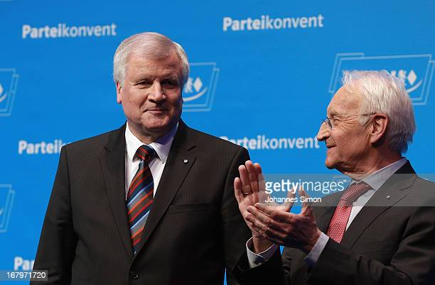 Edmund Stoiber former Governor of Bavaria applauds Horst Seehofer Governor of Bavaria and Chairman of the Bavarian Christian Democrats at the CSU...