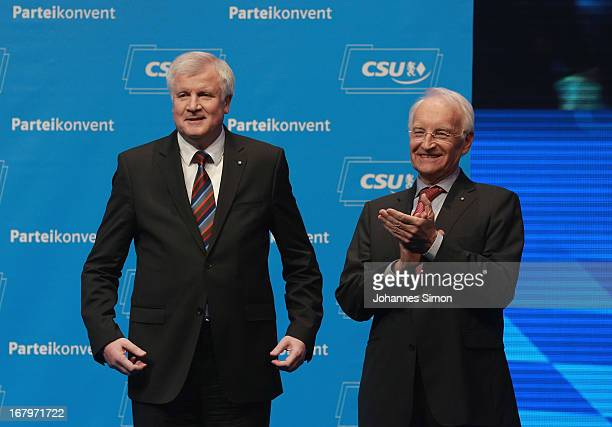 Edmund Stoiber former Governor of Bavaria applauds Horst Seehofer Governor of Bavaria and Chairman of the Bavarian Christian Democrats at the CSU...