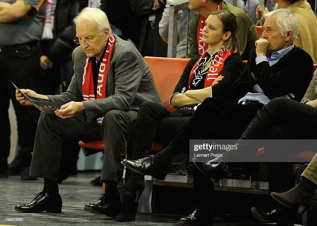 Edmund Stoiber, former Minister-President of Bavaria (L-R), his daughter-in-law Melanie Stoiber and Bernd Rauch, vice president of FC Bayern Muenchen watch the Beko Basketball match between FC Bayern Muenchen and Telekom Baskets Bonn at Audi-Dome on December 9, 2012 in Munich, Germany.