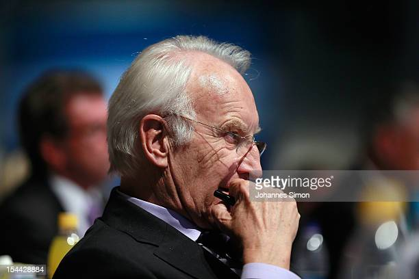 Edmund Stoiber former MinisterPresident of Bavaria listens to the speech of German Chancellor Angela Merkel during the Christian Social Union of...