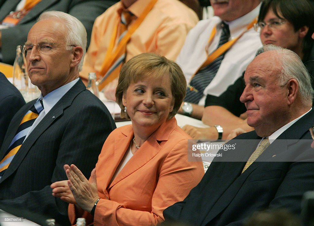 Edmund Stoiber, head of the Christian Social Union (CSU), <a gi-track='captionPersonalityLinkClicked' href=/galleries/search?phrase=Angela+Merkel&family=editorial&specificpeople=202161 ng-click='$event.stopPropagation()'>Angela Merkel</a>, head of the Christian Democratic Union (CDU) and former German Chancellor <a gi-track='captionPersonalityLinkClicked' href=/galleries/search?phrase=Helmut+Kohl&family=editorial&specificpeople=202518 ng-click='$event.stopPropagation()'>Helmut Kohl</a> attend the pre-election congress of the CDU August 28, 2005 in Dortmund, Germany. General elections in Germany take place on September 18, 2005.