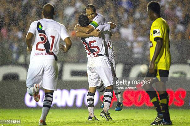 Edmundo and Diego Souza celebrates a scored goal during a match between Vasco da Gama and Barcelona of Quayaquil as part of Edmundo's farewell match...