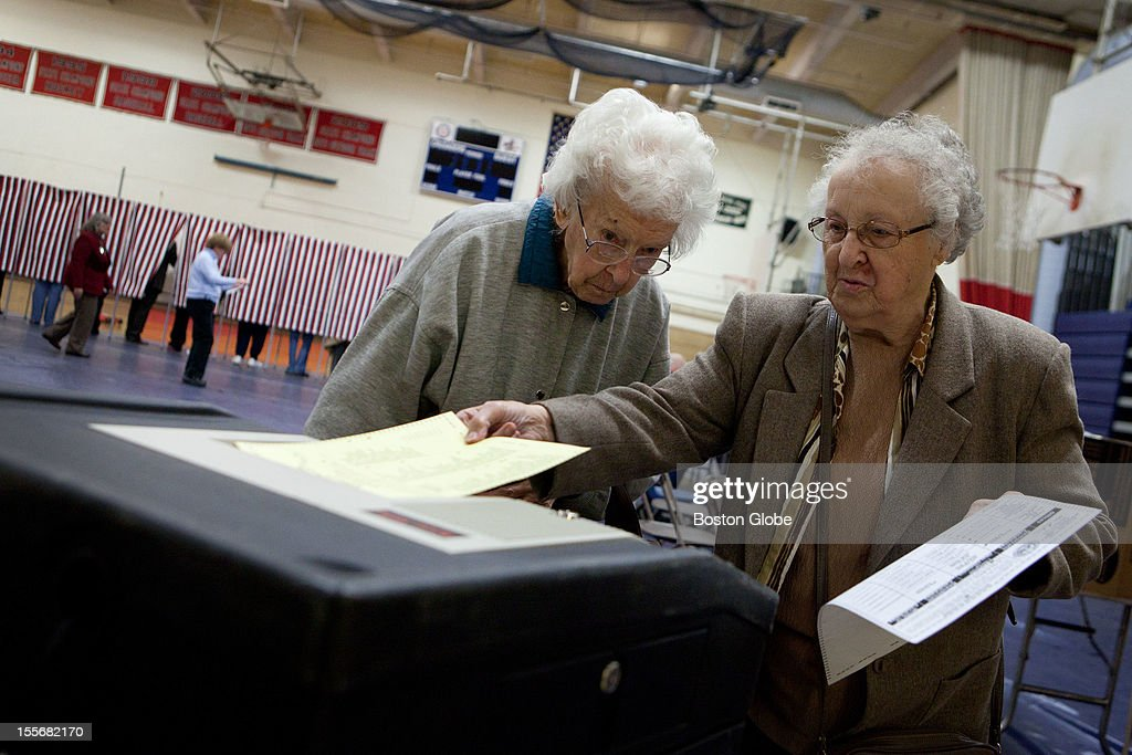 Edna Flanagan, left, 96, and Esther Theodore, 88, cast their ballots in the ballot box at Memorial High School in Manchester, New Hampshire on Election Day, November 6, 2012.
