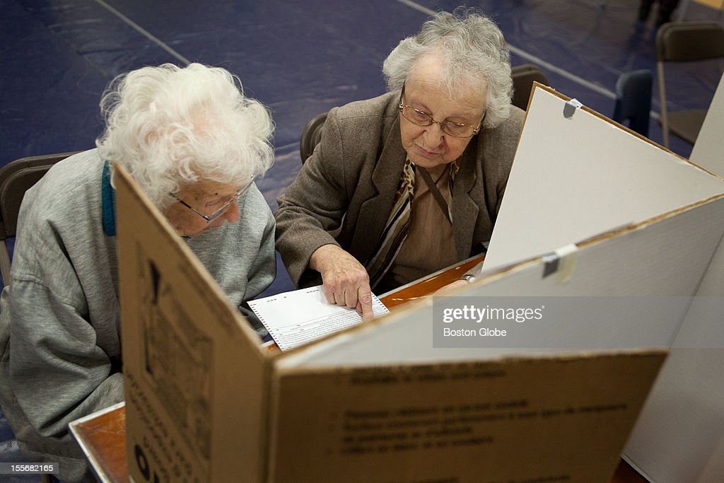 Edna Flanagan, left, 96, and Esther Theodore, 88, fill out voter ballots at Memorial High School in Manchester, New Hampshire on Election Day, November 6, 2012.