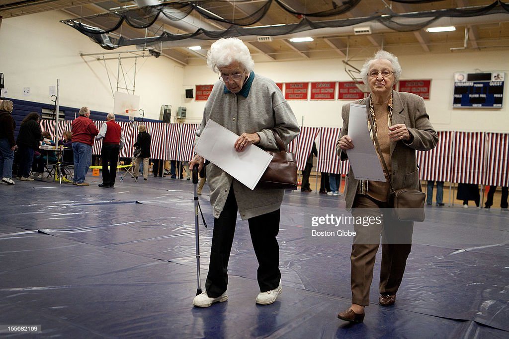 Edna Flanagan, left, 96, and Esther Theodore, 88, walk to the ballot box with their completed ballots in hand at Memorial High School in Manchester, New Hampshire on Election Day, November 6, 2012.