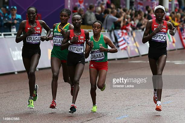Edna Ngeringwony Kiplagat of Kenya Tiki Gelana of Ethiopia Mary Jepkosgei Keitany of Kenya Mare Dibaba of Ethiopia and Priscah Jeptoo of Kenya during...