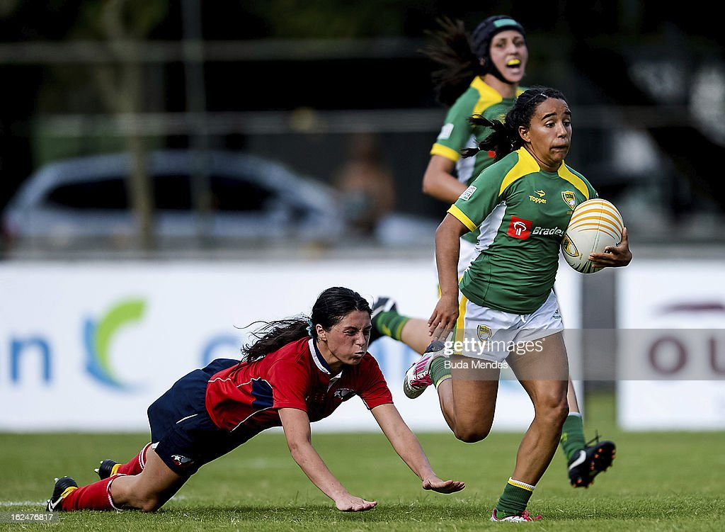 Edna Santini of Brazil (green jersey) fight for the ball during a rugby match as part of the Rio Sevens 2013 - South American Championship at the Gavea Stadium on February 23, 2013 in Rio de Janeiro, Brazil.