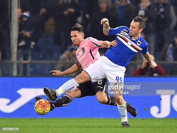 Edoardo Goldaniga of Palermo and Antonio Cassano of Sampdoria compete for the ball during the Serie A match between UC Sampdoria and US Citta di...