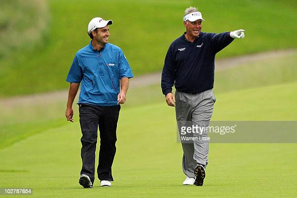 Edoardo Molinari of Italy and Darren Clarke of Northern Ireland on the 16th hole during round three of The Barclays Scottish Open at Loch Lomond Golf...
