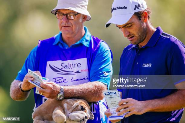 Edoardo Molinari of Italy and his caddie are seen at day one of the Saltire Energy Paul Lawrie Matchplay at Golf Resort Bad Griesbach on August 17...