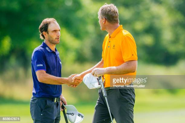 Edoardo Molinari of Italy and Robert Karlsson of Sweden shake hands at day one of the Saltire Energy Paul Lawrie Matchplay at Golf Resort Bad...