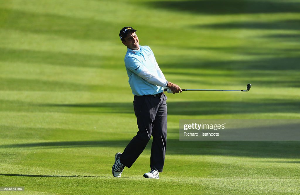 <a gi-track='captionPersonalityLinkClicked' href=/galleries/search?phrase=Edoardo+Molinari&family=editorial&specificpeople=556368 ng-click='$event.stopPropagation()'>Edoardo Molinari</a> of Italy hits his approach on the 4th hole during day one of the BMW PGA Championship at Wentworth on May 26, 2016 in Virginia Water, England.