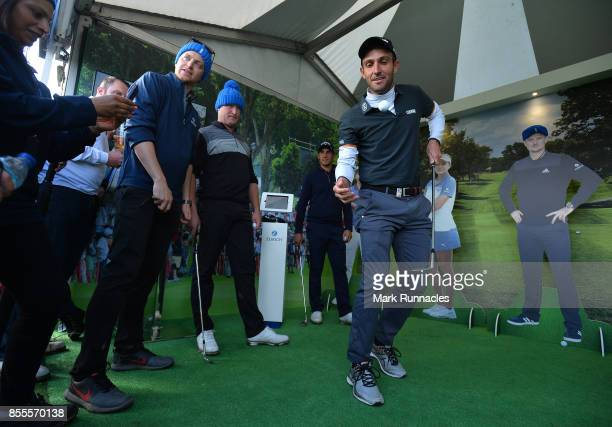 Edoardo Molinari of Italy is watched by Matteo Manassero of Italy and Jamie Donaldson of Wales as he takes part in the Keepy Uppys Challenge at the...