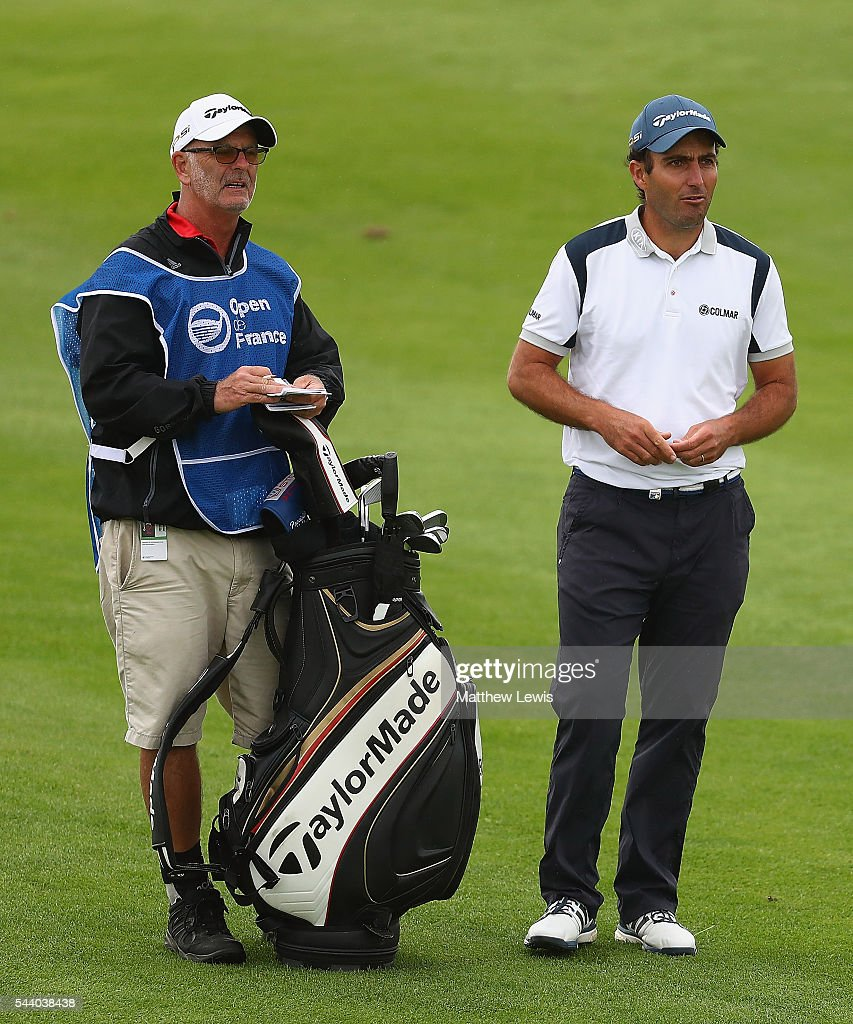 <a gi-track='captionPersonalityLinkClicked' href=/galleries/search?phrase=Edoardo+Molinari&family=editorial&specificpeople=556368 ng-click='$event.stopPropagation()'>Edoardo Molinari</a> of Italy looks on with his caddie during day two of the 100th Open de France at Le Golf National on July 1, 2016 in Paris, France.