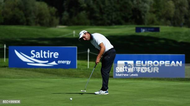 Edoardo Molinari of Italy makes a putt on the 18th green ahead of the Saltire Energy Paul Lawrie Matchplay at Golf Resort Bad Griesbach on August 16...
