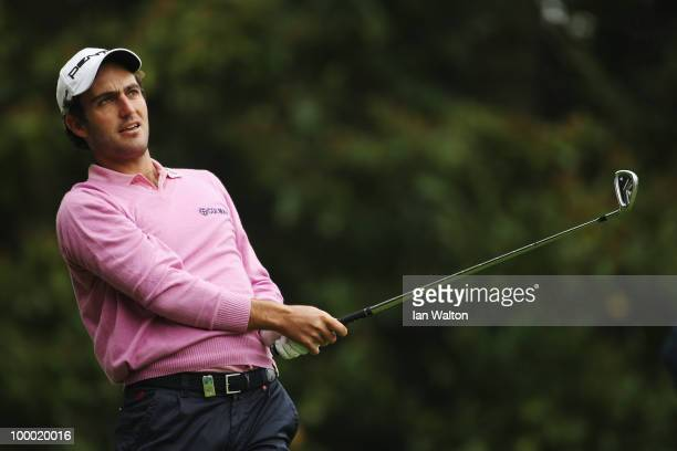 Edoardo Molinari of Italy plays a tee shot at the 2nd hole during the first round of the BMW PGA Championship on the West Course at Wentworth on May...