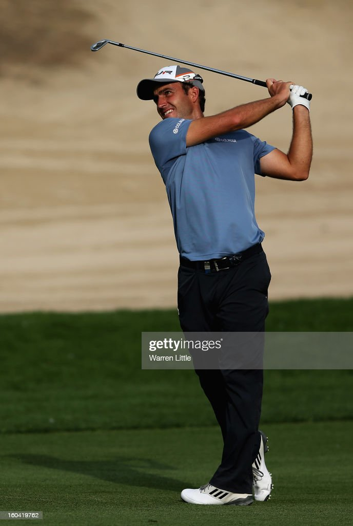 Edoardo Molinari of Italy plays his second shot into the eighth green during the first round of the Omega Dubai Desert Classic at Emirates Golf Club on January 31, 2013 in Dubai, United Arab Emirates.