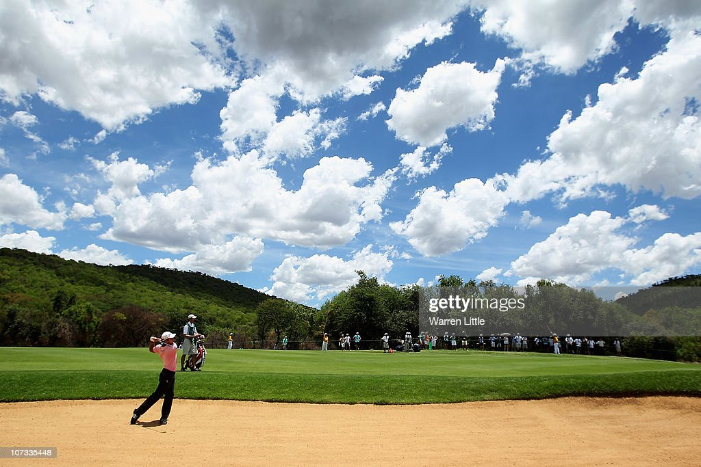Edoardo Molinari of Italy plays out of the third fairway bunker during the final round of the 2010 Nedbank Golf Challenge at the Gary Player Country...
