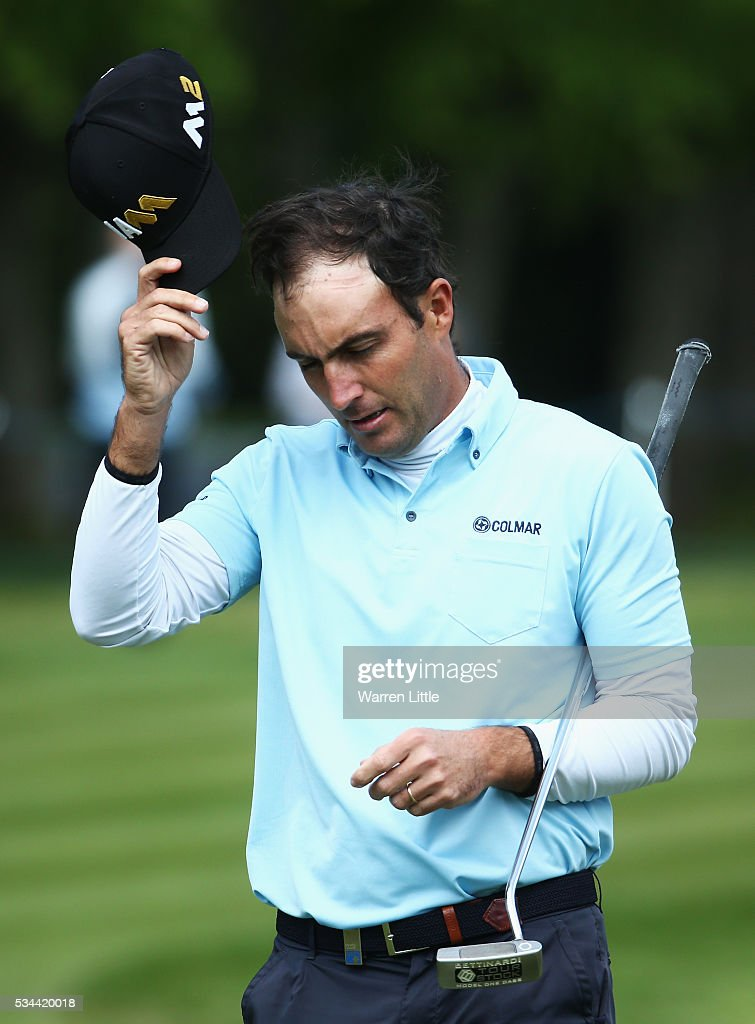 <a gi-track='captionPersonalityLinkClicked' href=/galleries/search?phrase=Edoardo+Molinari&family=editorial&specificpeople=556368 ng-click='$event.stopPropagation()'>Edoardo Molinari</a> of Italy reacts on the 18th green during day one of the BMW PGA Championship at Wentworth on May 26, 2016 in Virginia Water, England.