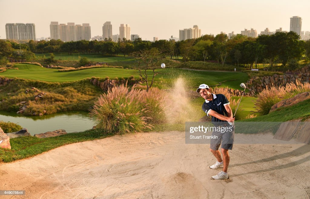 Edoardo Molinari of Itlay plays a shot from the greenside bunker on the 17th hole during practice prior to the start of the Hero Indian Open at Dlf Golf and Country Club on March 7 2017 in New Delhi, India.