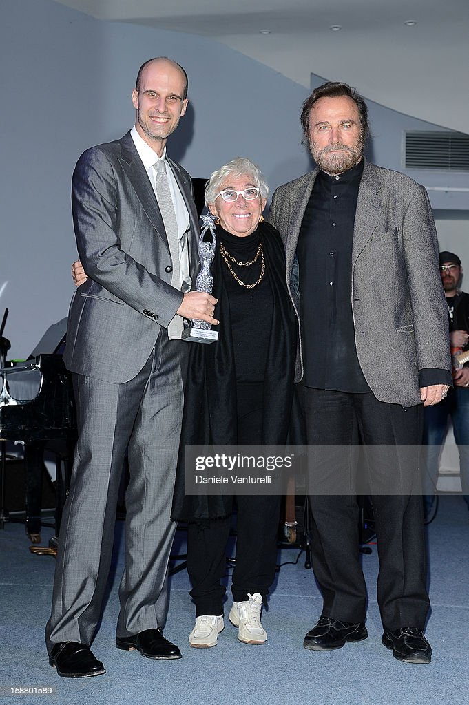 <a gi-track='captionPersonalityLinkClicked' href=/galleries/search?phrase=Edoardo+Ponti&family=editorial&specificpeople=851141 ng-click='$event.stopPropagation()'>Edoardo Ponti</a>, Lina Wertmuller and <a gi-track='captionPersonalityLinkClicked' href=/galleries/search?phrase=Franco+Nero&family=editorial&specificpeople=803339 ng-click='$event.stopPropagation()'>Franco Nero</a> attend Day 4 of the 2012 Capri Hollywood Film Festival on December 29, 2012 in Capri, Italy.