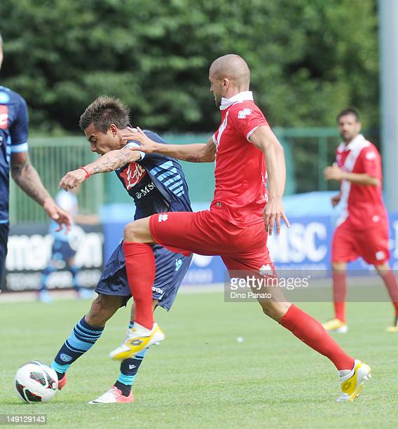 Edoardo Vargas of Napoli competes with Emanuele Padella of Grosseto during the preseason friendly match between SSC Napoli and US Grosseto on July 23...