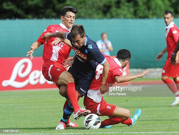 Edoardo Vargas of Napoli his tackled to Marco Crimi of Grosseto during the preseason friendly match between SSC Napoli and US Grosseto on July 23...