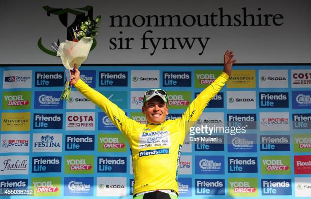 Edoardo Zardini of Bardiani CSF celebrates on the podium after receiving the Friends Life Yellow Jersey following Stage Three of the 2014 Tour of...