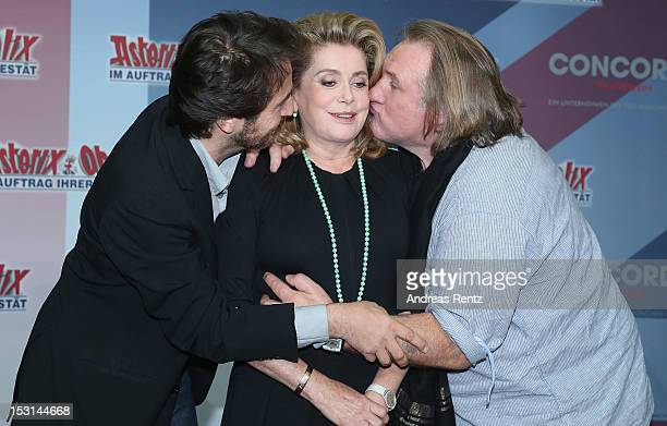 Edouard Baer Catherine Deneuve and Gerard Depardieu attend the 'Asterix Obelix God Save Britannia' photocall at Hotel de Rome on October 1 2012 in...
