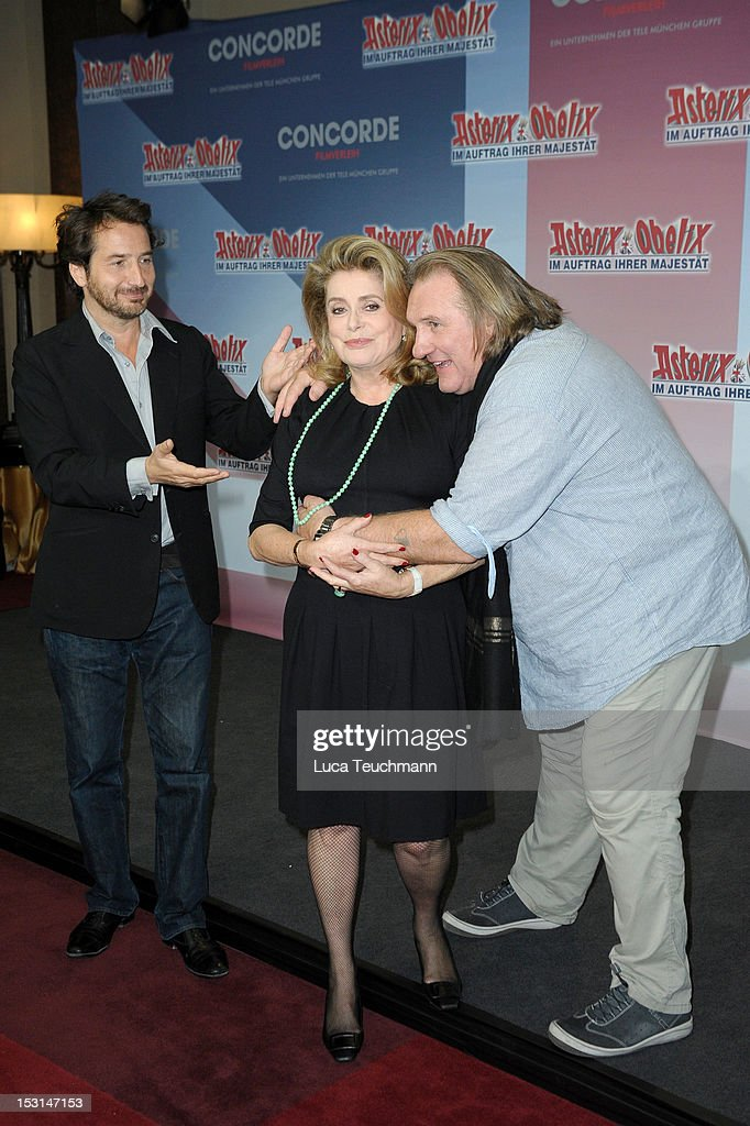 Edouard Baer, Catherine Deneuve and Gerard Depardieu attend the 'Asterix & Obelix - God Save Britannia' Photocall at Hote de Rome on October 1, 2012 in Berlin, Germany.