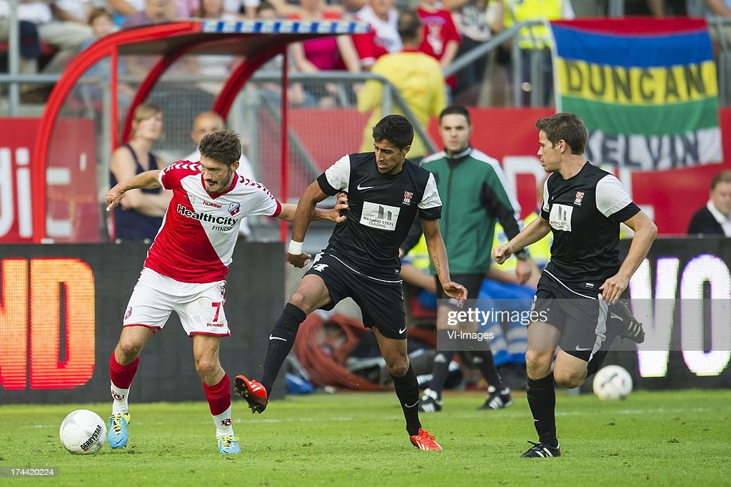 Edouard Duplan of FC Utrecht, Andre Filipe Rodrigues de Almeida of FC Differdange 03, Andy May of FC Differdange 03 during the Europa League second qualifying round match between FC Utrecht and FC Differdange on July 25, 2013 in Utrecht, The Netherlands.